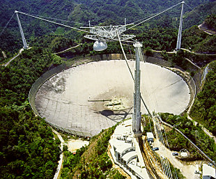 Arecibo Observatory, a 305-meter-wide radio telescope (courtesy of the NAIC - Arecibo Observatory, a facility of the NSF)