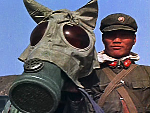 A Chinese soldier and his horse prepare to participate in exercises during a nuclear test
